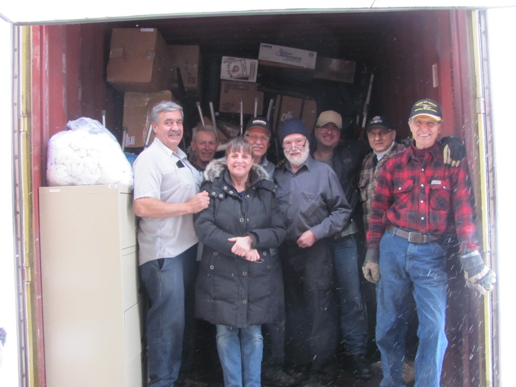 MEMO volunteers finish packing 55th container in a snow storm