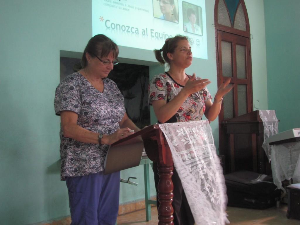 NURSE MARTHA DELGATO ( right) INTERPRETES WHILE ST. JOES NURSE LORI OWENS (left) TEACHES ASPECTS OF SENIOR CARE IN SANTA CLARA,CUBA