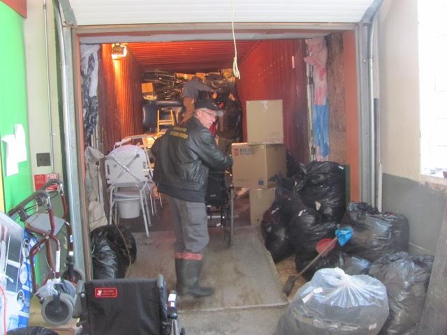 Note how the container is packed tightly with rags against the building to keep the cold out. The garbage bags used for packing and protecting the containers contents in transit, become bags of clothing when they get to Cuba.