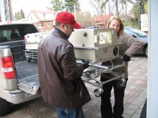 Steve Weibe unloading incubater for MEMO