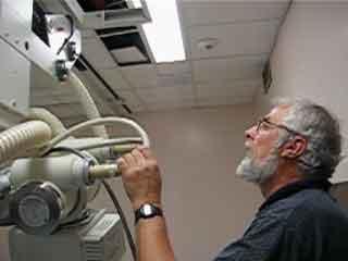 Erwin Stuka pondering over an xray machine
