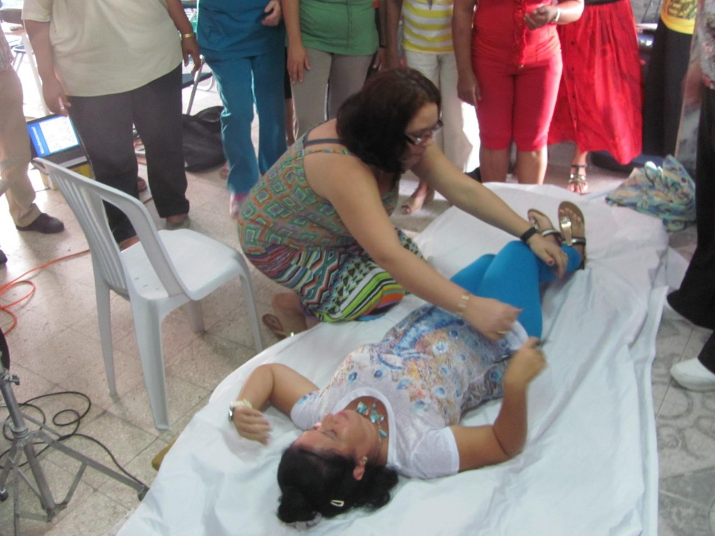IN HAVANA, WORKSHOP PARTICIPANT DEMONSTRATES PROPER TURNING IN BED WITH FELLOW PARTICIPANT
