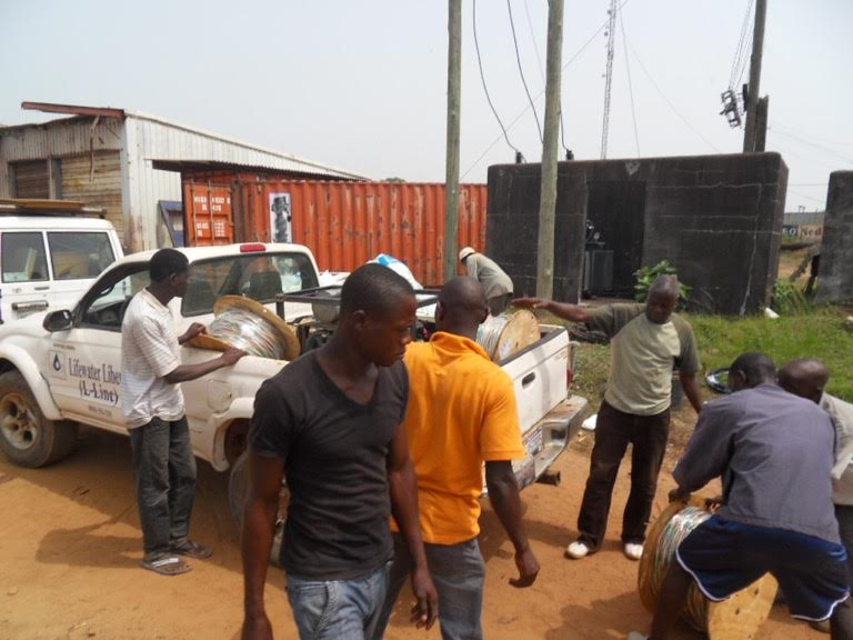 LIBERIAN LIFE WATER WORKERS LOADING THE STUFF THUNDER BAY LIFEWATER SENT IN THE CONTAINER
